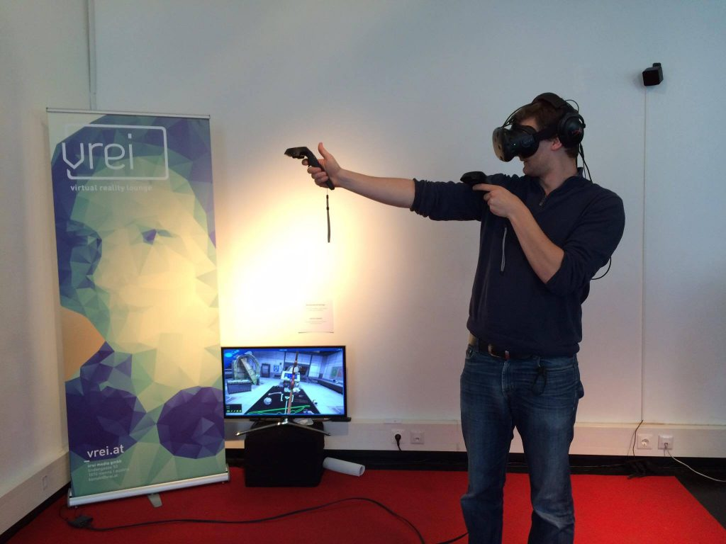 "Philipp in action during our visit at vrei: trying out ""The Lab"" with the HTC Vive"