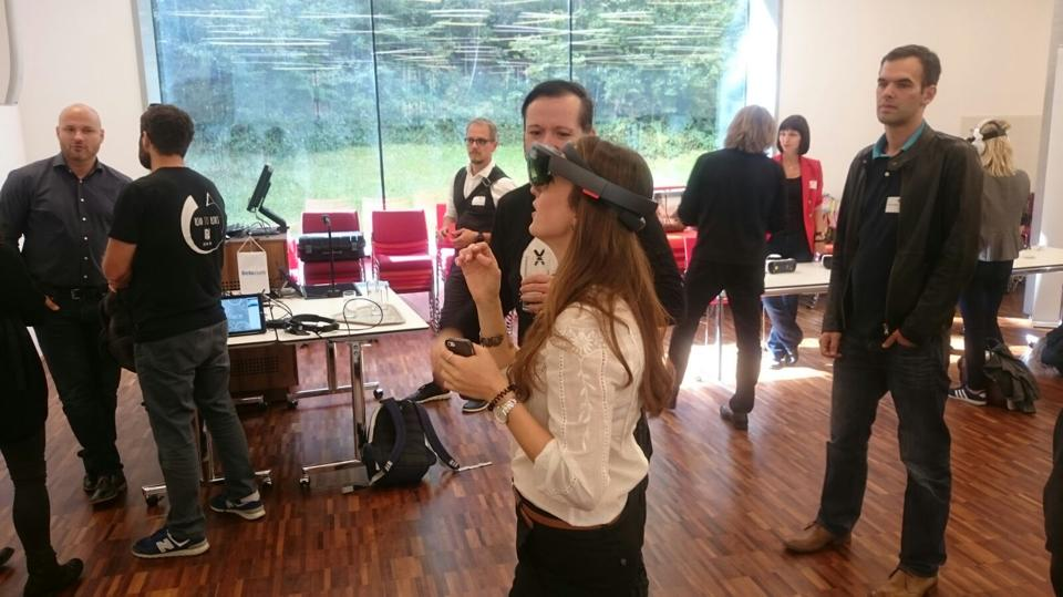 Alina experiencing the Microsoft HoloLens. Can you think of a touristic use case for the HoloLens? Get in touch and share it with us!